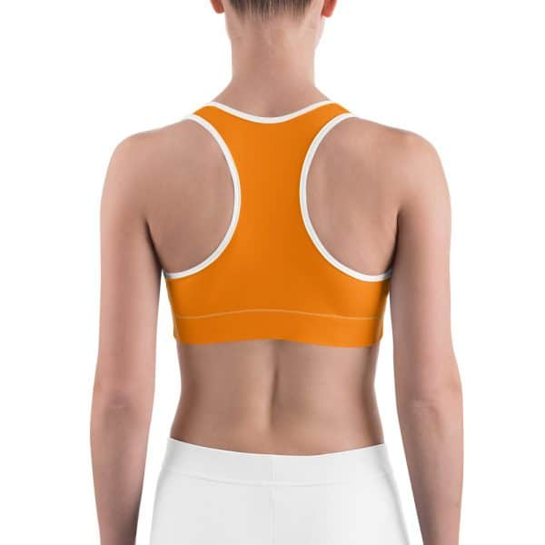 Her Everyday Sports Bra (Turmeric) on woman's back