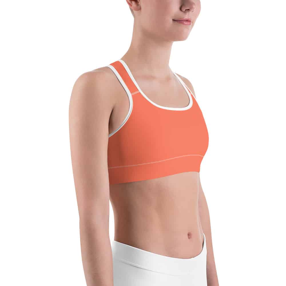 Her Everyday Sports Bra (Living Coral) on woman front angle